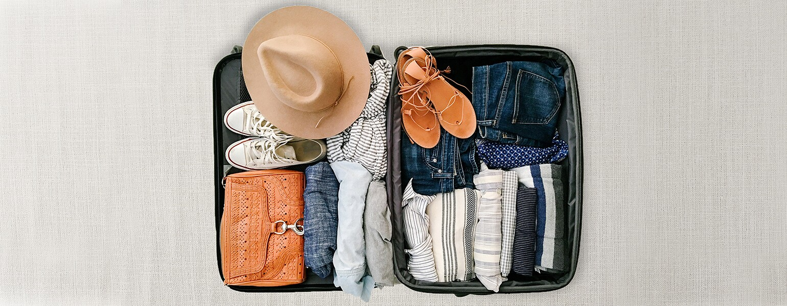 image of open suitcase neatly packed