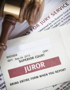 Documents requesting jury duty with gavel