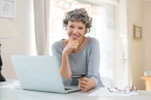Woman shopping online for last minute holiday gifts