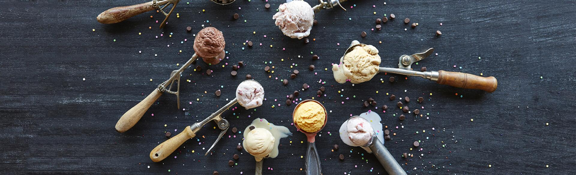 A photo of a group of ice cream scoops holding healthy ice cream.