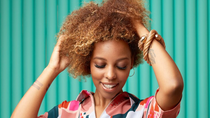 image_of_woman_with_hands_in_her_hair_Stocksy_txp06611773n9u200_Large_2787150_1800