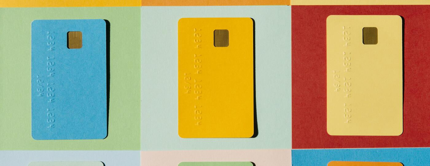 Colorful Credit Cards On Colorful Checked Background