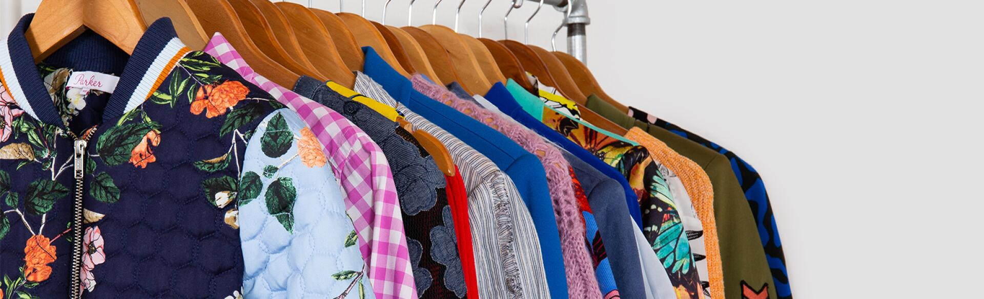 image of clothes on rack by armoire
