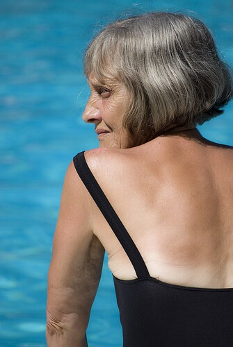 Profile of a beautiful older woman at a swimming pool