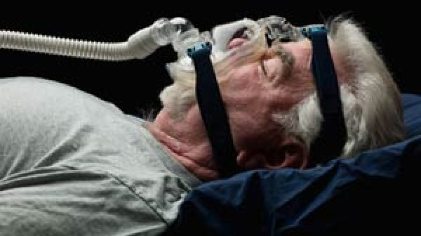 Man with sleep apnea wears a mask