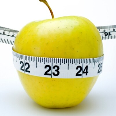 weight loss after 50 showing apple and tapemeasure