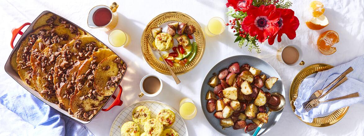 brunch table with waffles, potatoes and egg muffins