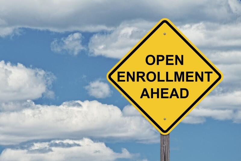Caution Sign Blue Sky Background - Open Enrollment Ahead
