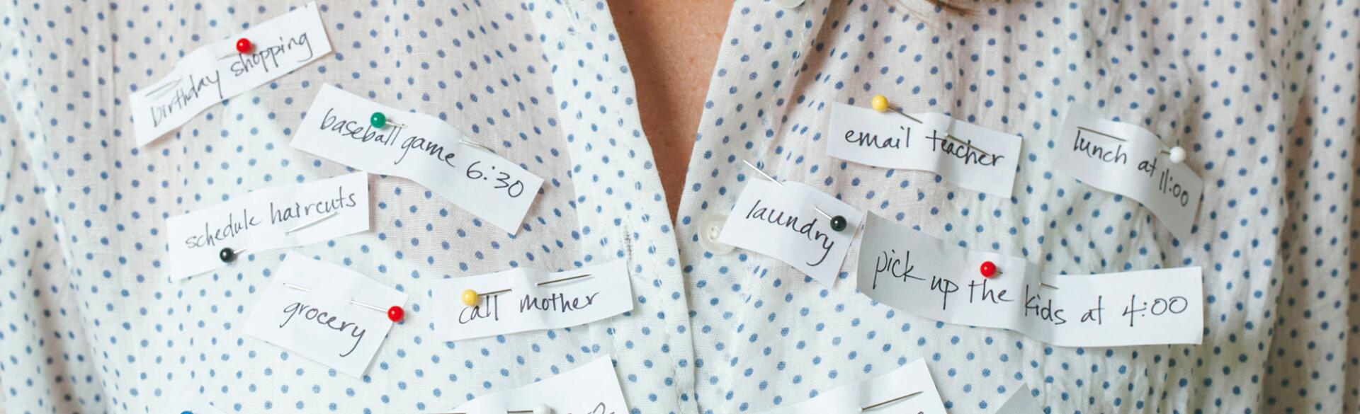 Busy Woman With Reminders Pinned To Her Shirt