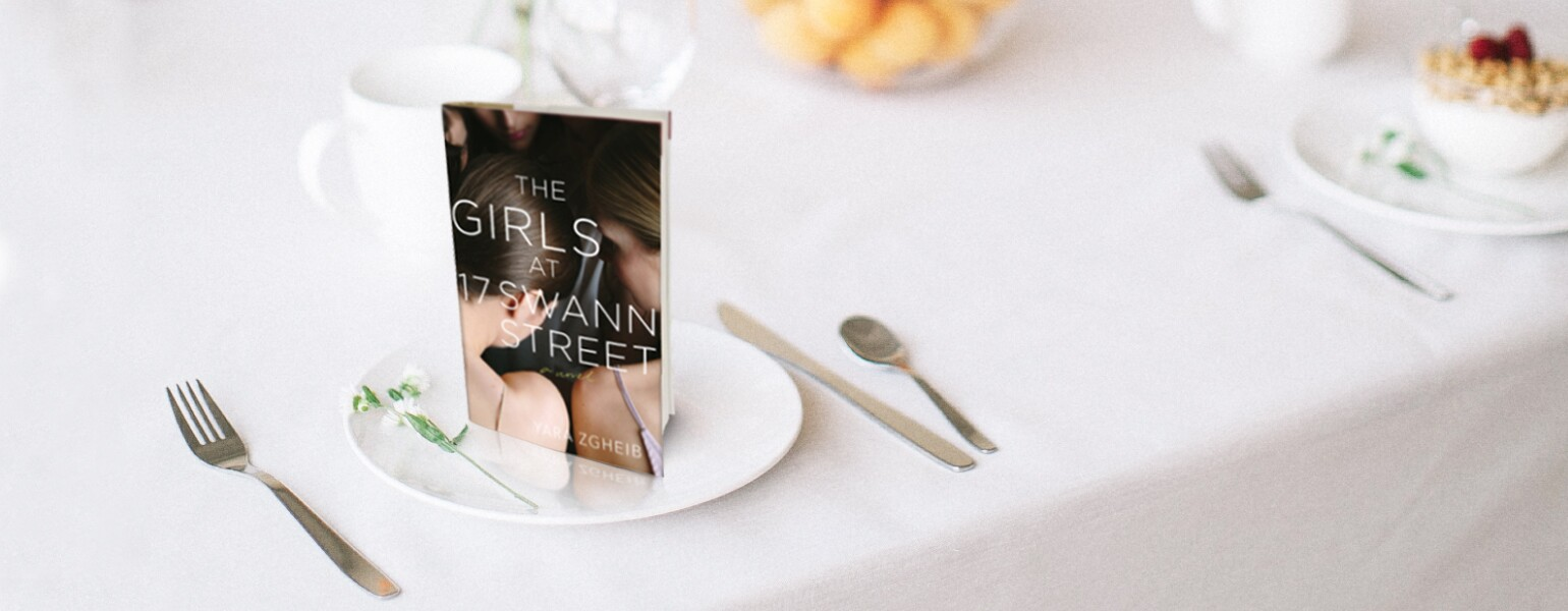 An image of Yara Zgheib's new novel, The Girls at 17 Swann Street, staged on a dining table.