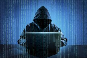 WiFi hacker using laptop