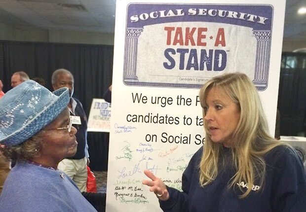 talking at a Stand for Social Security event