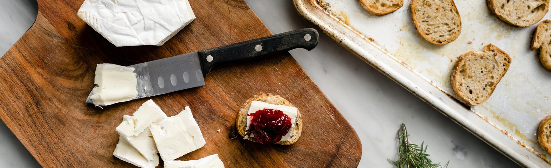 Making Cranberry Brie Toast Bites easy appetizer for a girls night in