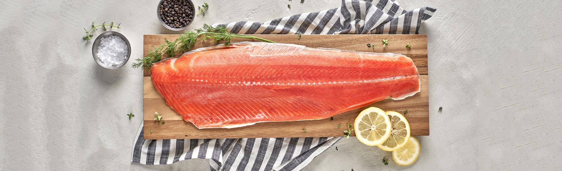 salmon filet on wooden slab shown for brain food
