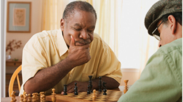 Senior men may require different activities in assisted living facilities-two men play chess