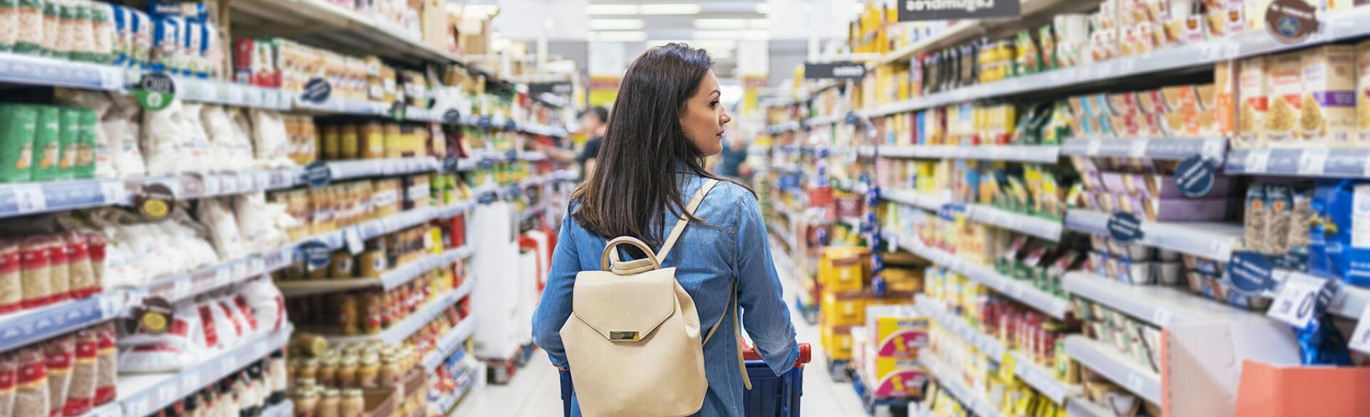 Back View Of Beautiful Woman Buying Food In A Supermarket