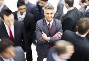 Older Job seeker standing out in crowd