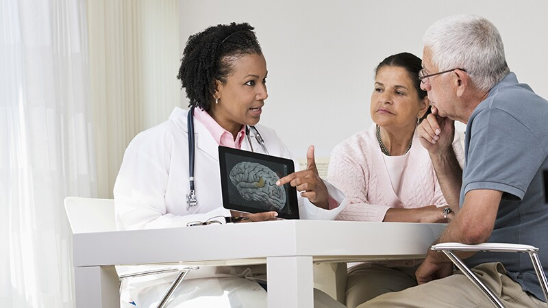 A female doctor showing a brain X-ray to a patient