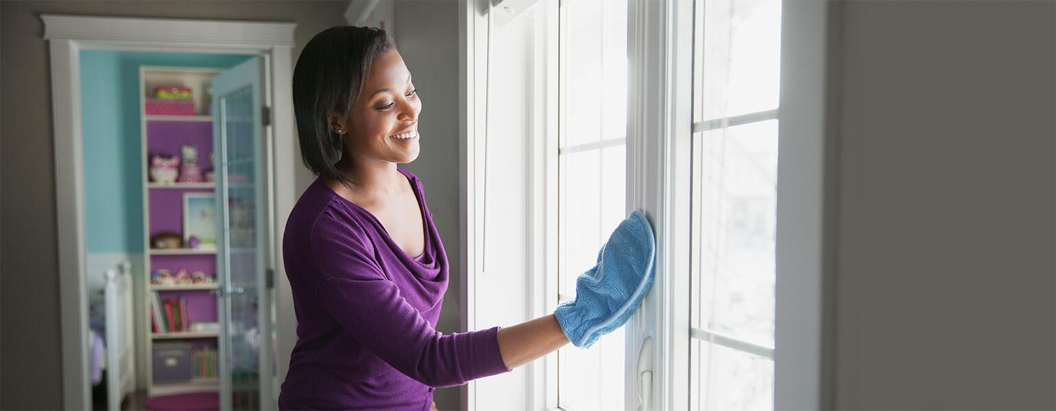 image_of_woman_cleaning_a_window_GettyImages-608163079_1540x600_new