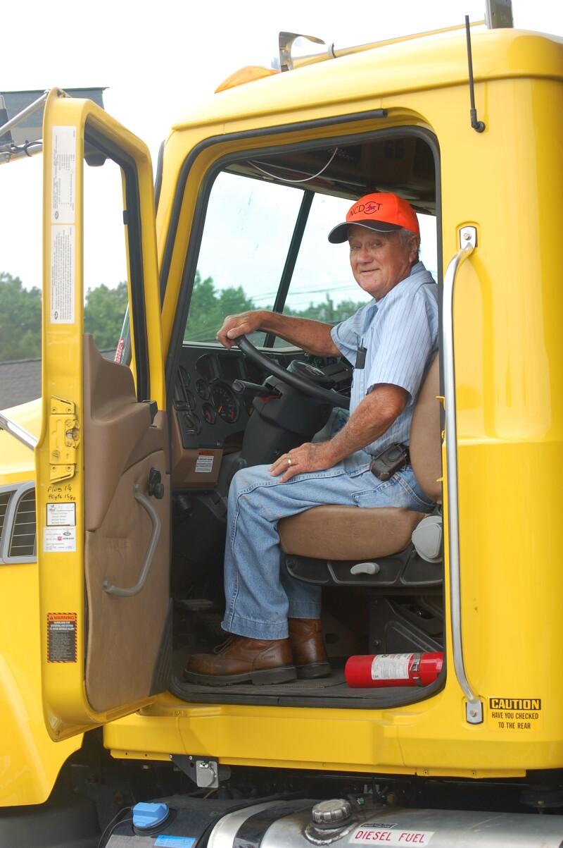 Older man in his work truck
