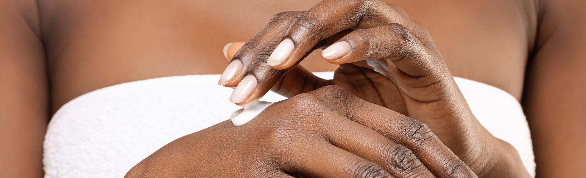 image_of_hands_applying_lotion_GettyImages-1192085595_1800