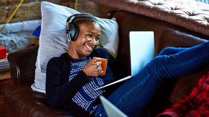 image_of_woman_laying_on_sofa_with_laptop_GettyImages-1145041102_1800