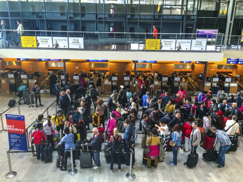 People waiting to make check-in for their flight