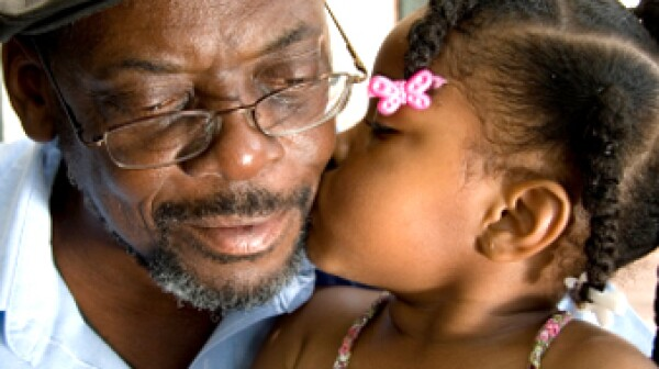 black child kissing black grandpa