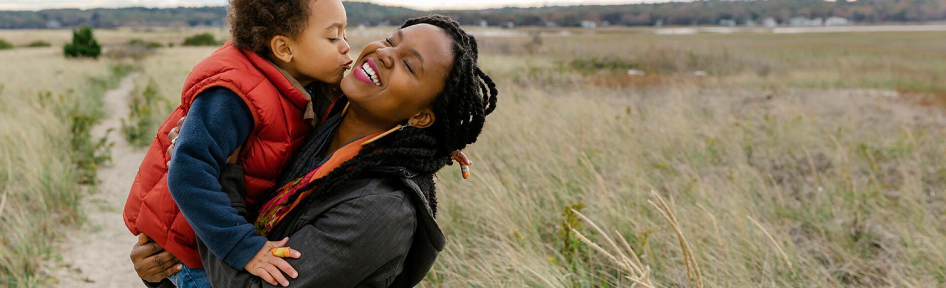 image_of_black_mother_holding_small_child_against_landscape_Stocksy_txpf9d9135aWFX200_OriginalDelivery_1284835_1540.jpg