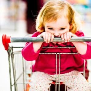 sad girl in grocery cart