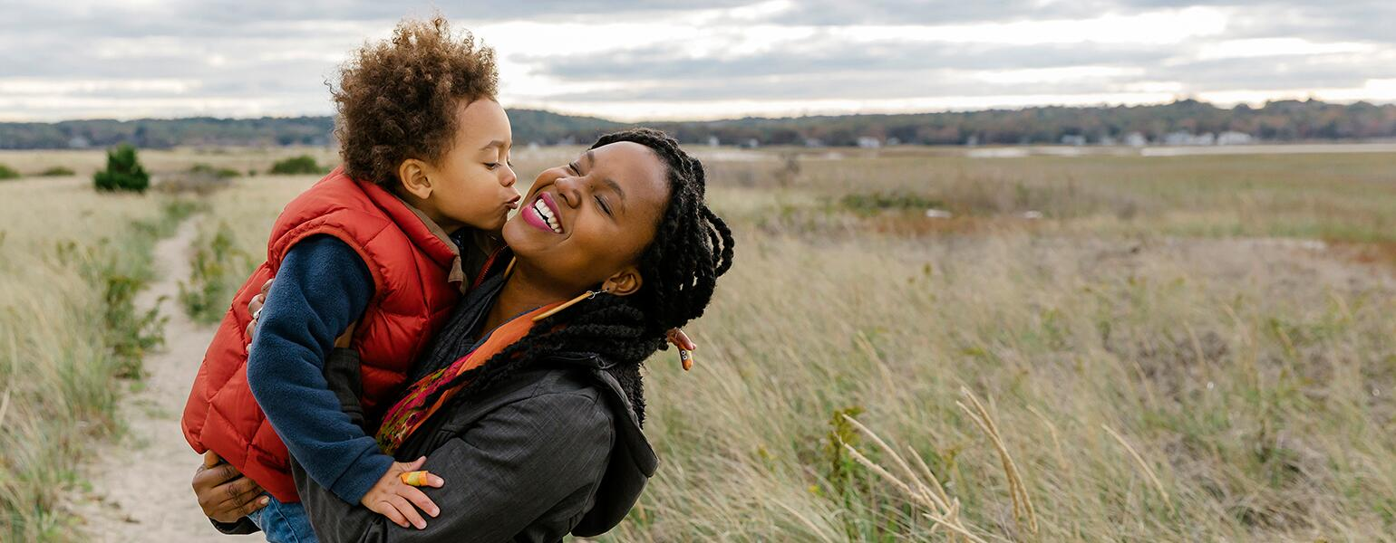 image_of_black_mother_holding_small_child_against_landscape_Stocksy_txpf9d9135aWFX200_OriginalDelivery_1284835_1540.jpg