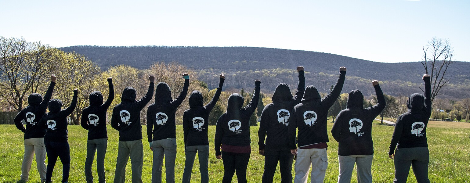 image_of_group_of_hikers_with_fists_in_air_Outdoor Afro_FistsUp_1540.jpg