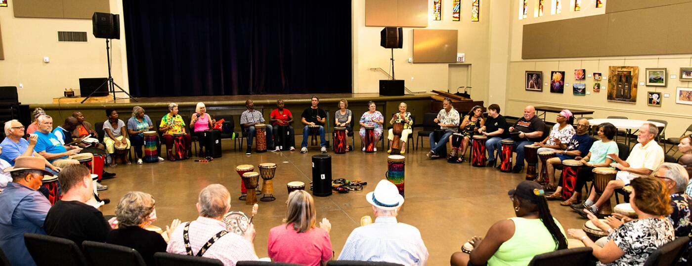 image_of_group_of_people_sitting_in_a_large_circle_with_drums_and_instruments_DrumCirlces_SistersFromAARP_DeannaReid-7380_1540.jpg