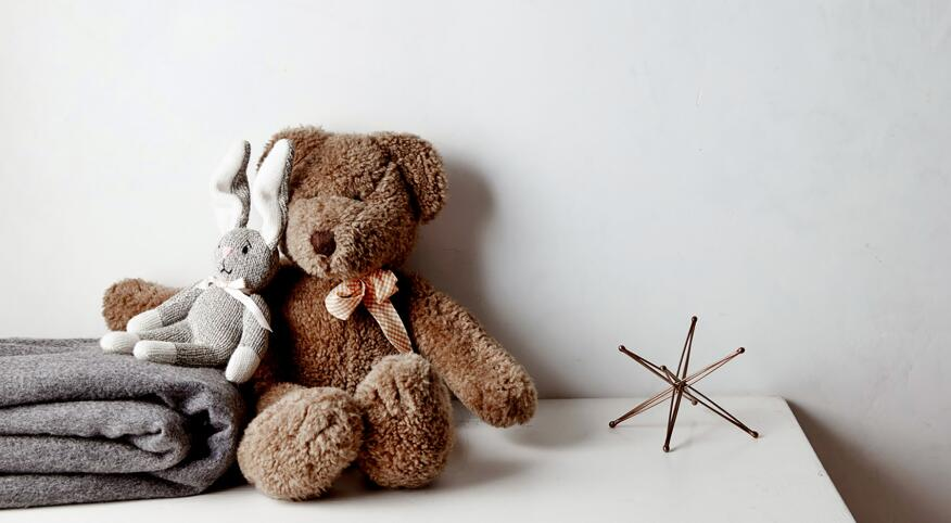 childhood stuffed animals, a bear and a bunny sitting next to each other