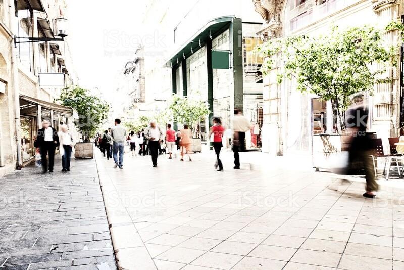 blurry people walking on pedestrian street