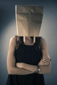 Woman with brown paper bag over head