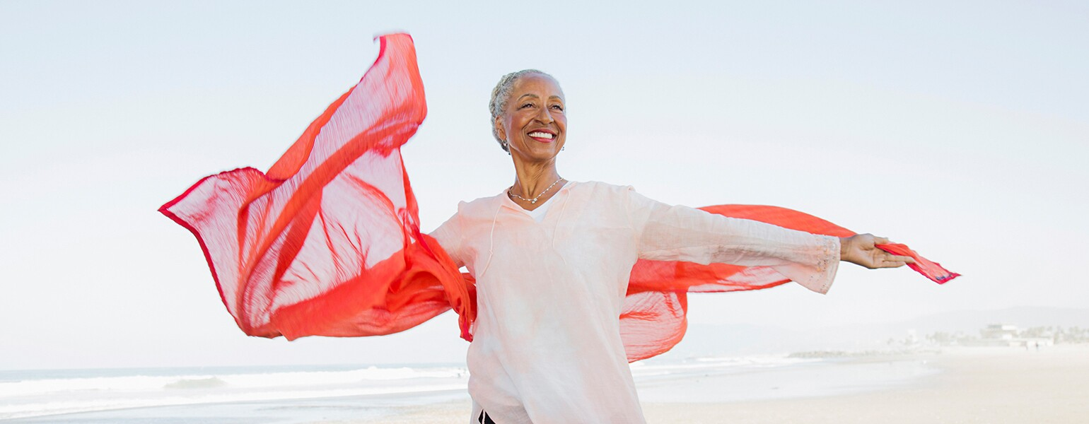 image_of_mature_black_woman_on_beach_GettyImages-905548586_1540.jpg