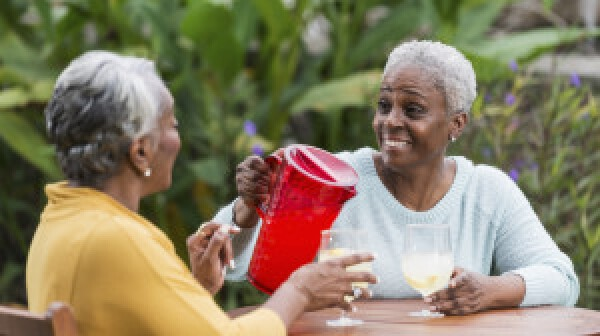 Two older women having lemonade