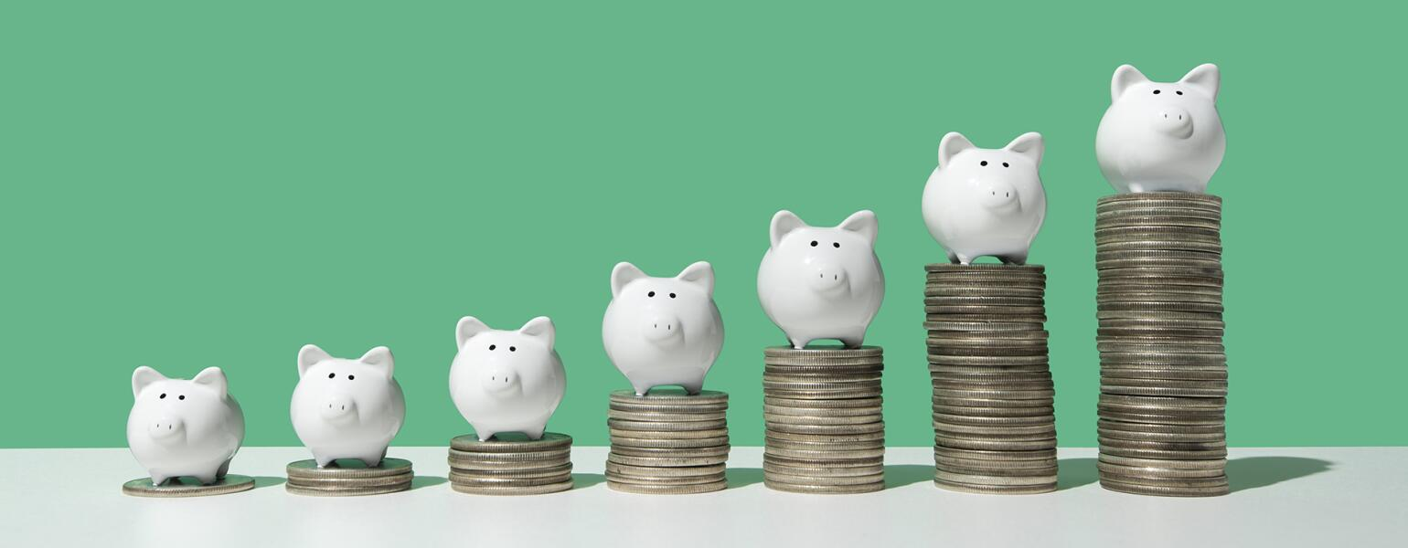 Little piggy banks on ascending stacks of coins Jean Chatzy how to save enough for retirement