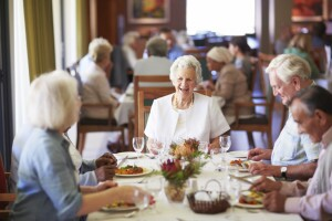 Older adults reminiscing with friends