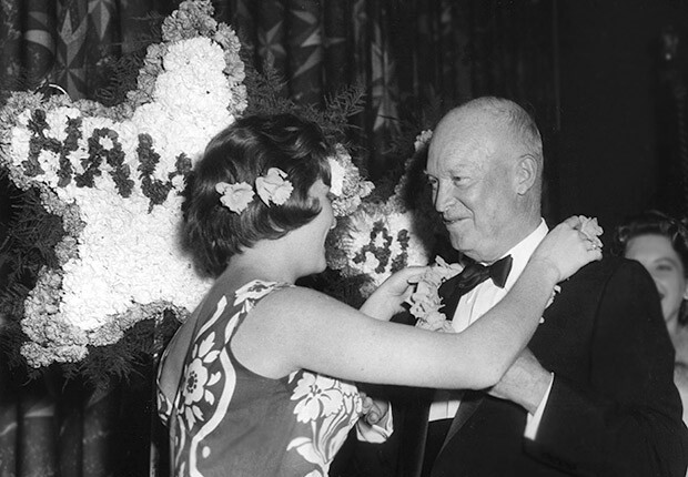 President Dwight D. Eisenhower receives lei in celebration of Hawaii Statehood