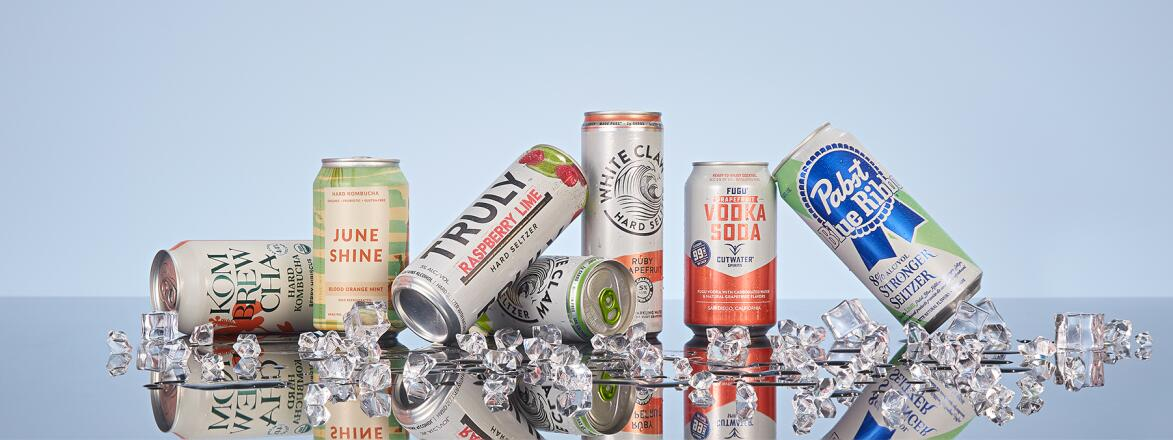 A group of hard seltzer cans on ice