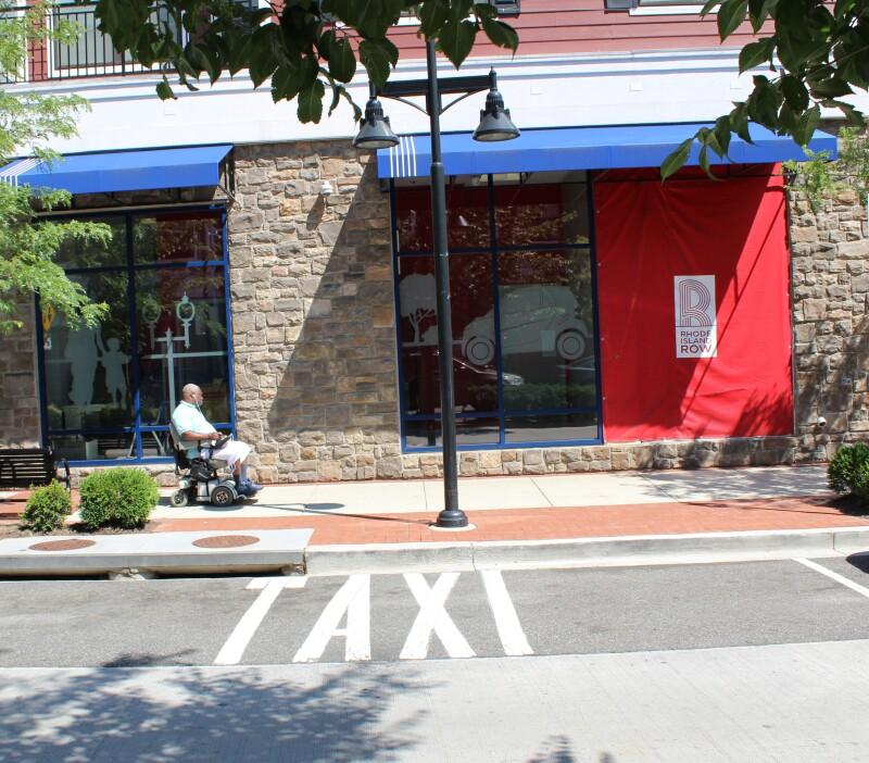 Pedestrian in motorized chair