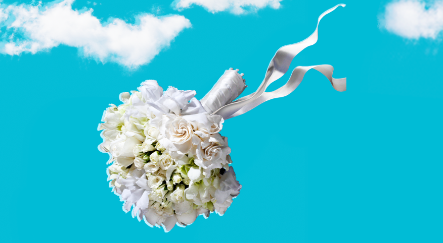 Bouquet of wedding flowers flying in the air