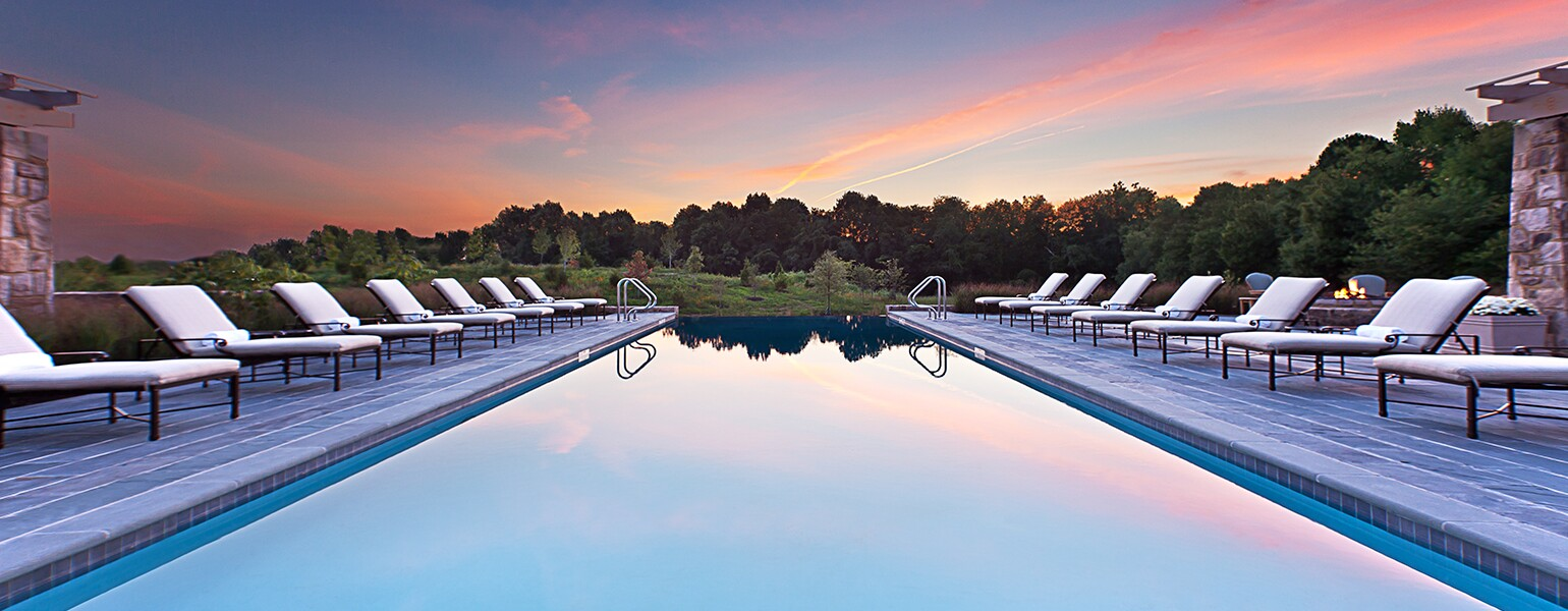 A photo of an in-ground pool at a luxury spa.