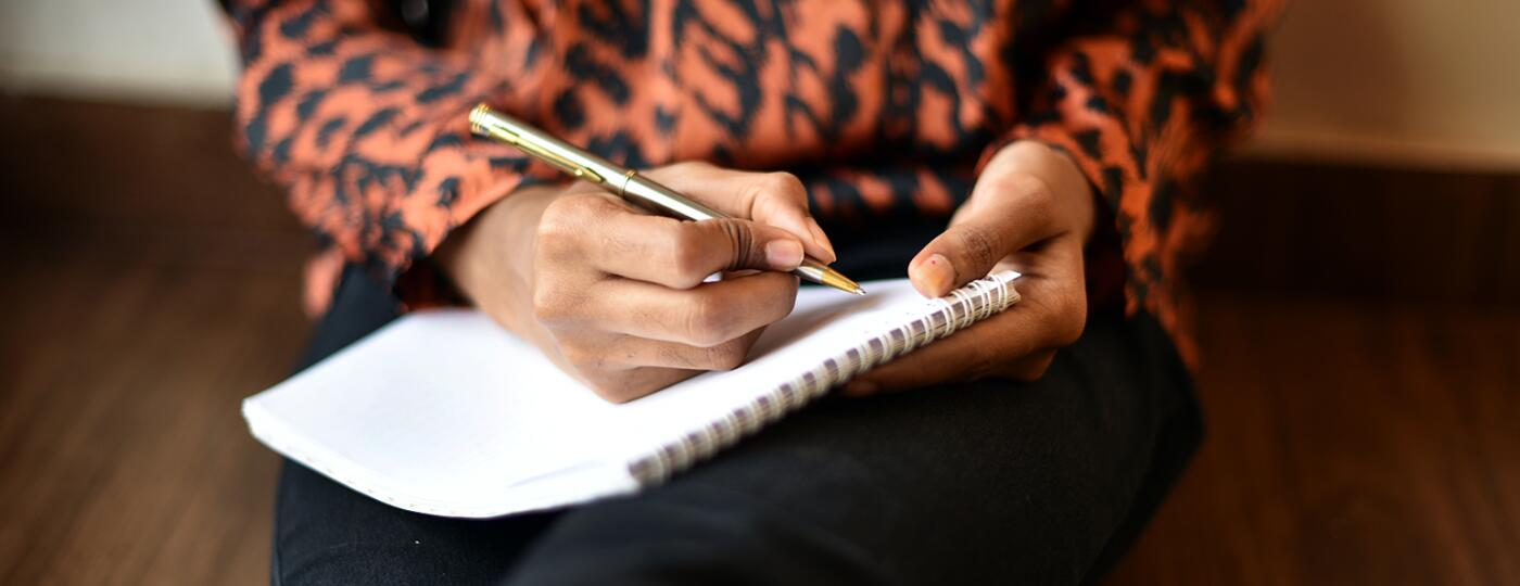 image_of_womans_hands_writing_in_notebook_GettyImages-1020523958_1540.jpg