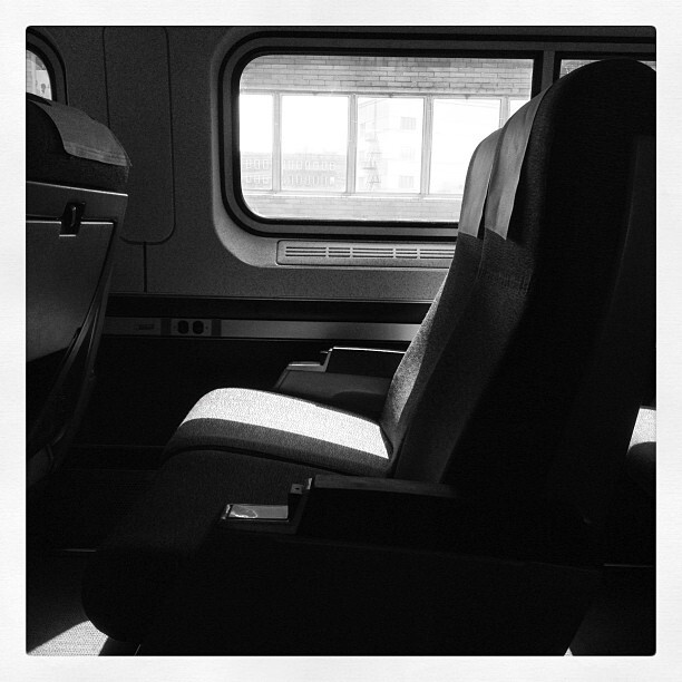 Black and white photo of a seat in the quiet car