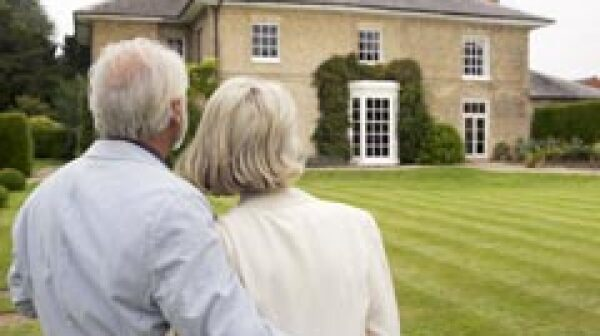 Senior couple admiring house.