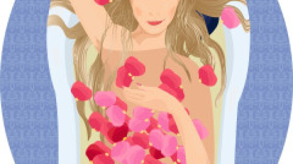 Blonde woman taking a bath with rose petals