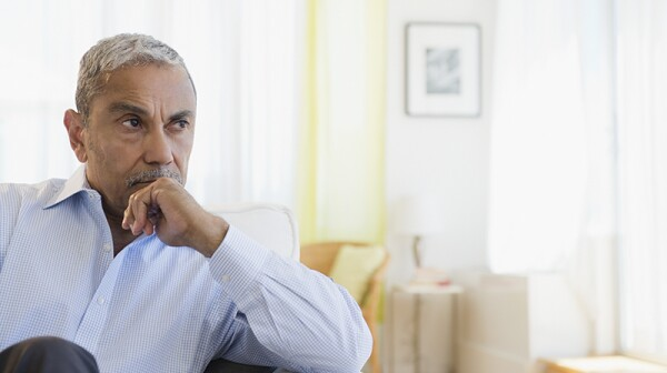 A man sitting in a home and thinking